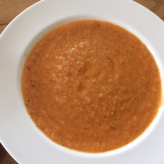 A bowl of tomato, courgette and pepper soup