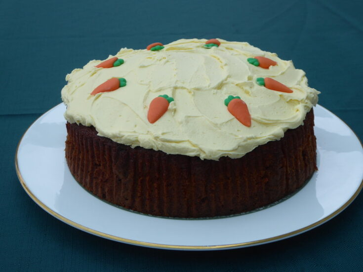 Pam's cracking carrot cake, topped with delicious cream cheese frosting and cute little fondant icing carrots