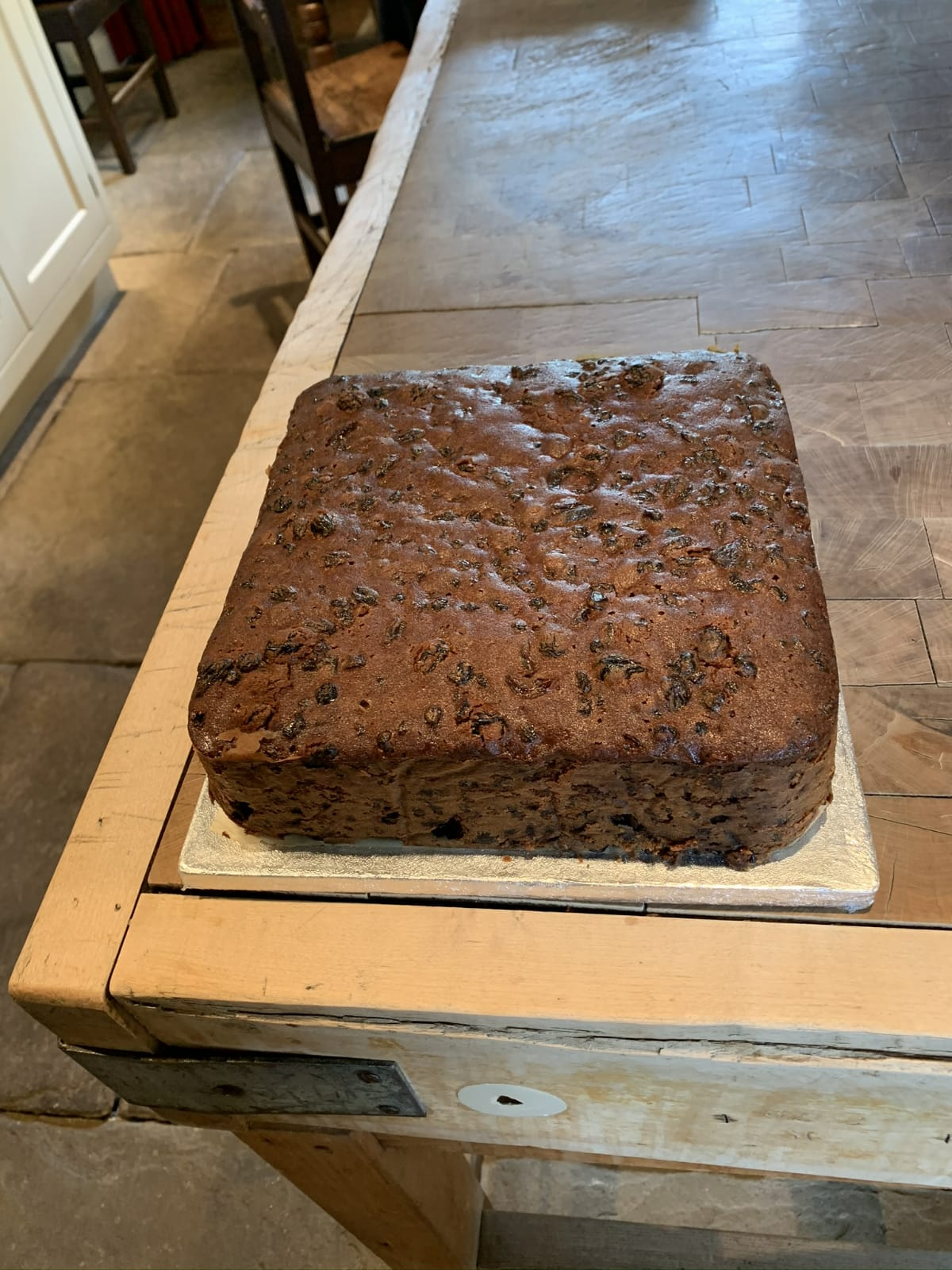 The cake is ready, removed from the tin and placed on a board ready for serving