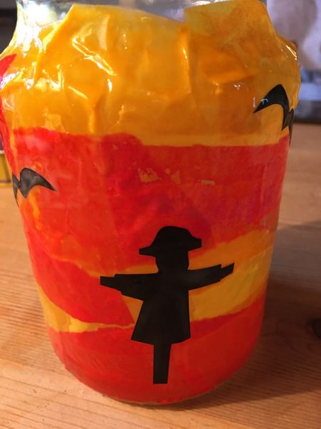 The scarecrow and crows have been stuck to the jar and more glue applied over them, to keep them properly secure