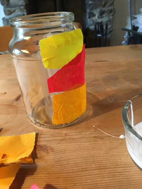 Tissue paper stuck to part of the jar to resemble a sunset