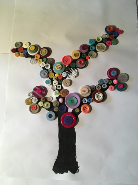 A beautiful tree, made of buttons stuck to a painted trunk and branches on paper