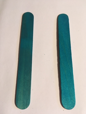 Two craft/lollipop sticks, set parallel to each other with a small gap between