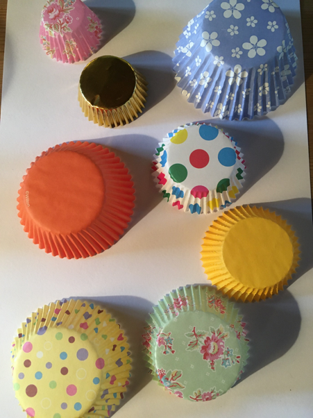 Lots of colourful paper cake cases