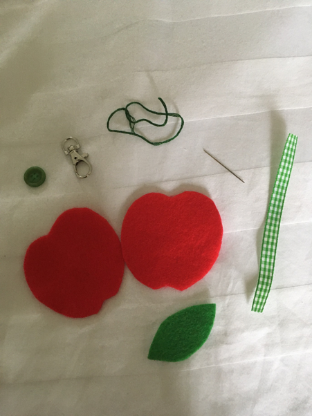 Cut the apple out according to your template and assemble your materials