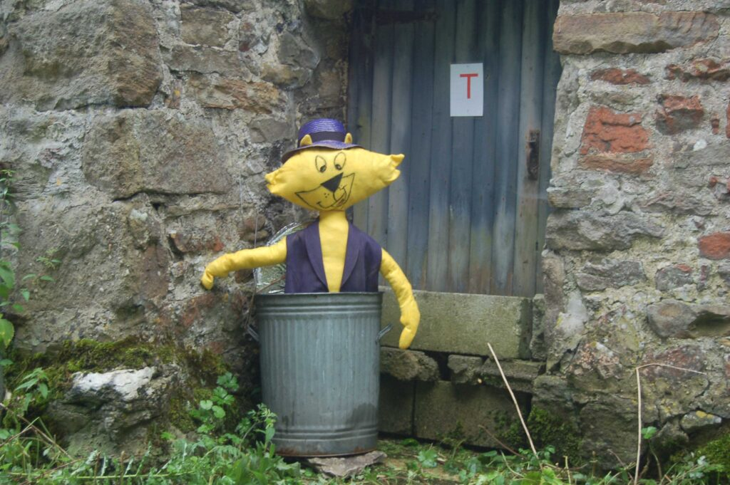 This cheeky character is right at home in the dustbin, a yellow cat who looks like he's had his share of brushes with the law. He still looks like he's probably the boss, though, he's a real...