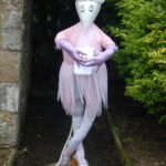 Why, we seem to have a ballerina here, although she looks much like a mouse. I think she's looking for the sugar plum fairies!