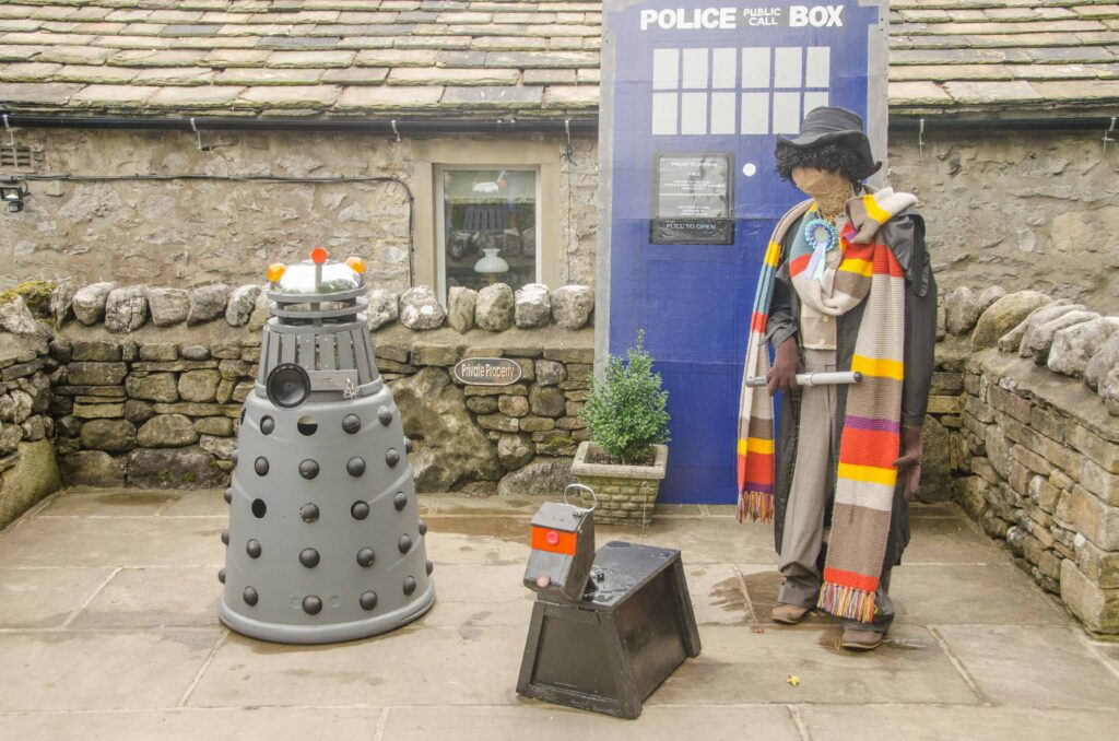 This scarecrow is sporting a rather long, colourful, scarf, for which he's well-known on this planet, and perhaps in other dimensions of space and time. But he needs to watch out, as it seems he and his faithful cyberdog are about to be exterminated